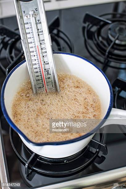 saucepan with thermometer, sugar, honey and inverted sugar syrup for making turron, elevated view - nougat stock pictures, royalty-free photos & images