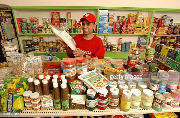 Saucy column on Burmese grocery store guy in pix is Win pls chk sp