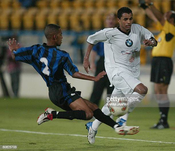 Saud Ghanem of AlSadd club fights for the ball with Khaled Nouredin of alSaylia club during their Prince Cup match at alIttihad stadium in Doha 11...