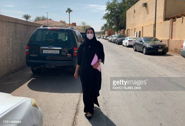 Saudi activist Loujain al-Hathloul is pictured on her way to the state security court in the Saudi capital Riyadh on March 2, 2021. - The family of...