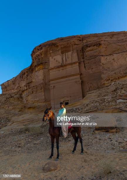 Saudi actor riding a horse during a play in an open air theater in Madain Saleh, Al Madinah Province, Alula, Saudi Arabia on December 27, 2019 in...
