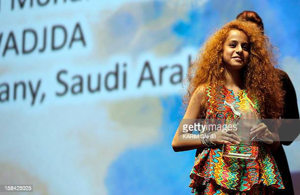Saudi Actress Waad Mohammed accepts the Muhr Arab Feature award for her film 'Wadjda' during the at the Dubai International Film Festival in the Gulf...