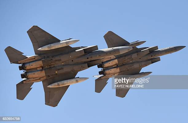 Saudi Air Force advanced F15SA fighter jets perform during a ceremony marking the 50th anniversary of the creation of the King Faisal Air Academy at...