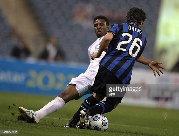 Saudi AlHilal club player Mohammed Noor vies with Inter Milan's Christian Chivu during their friendly football match in Riyadh on January 2 2010 AFP...