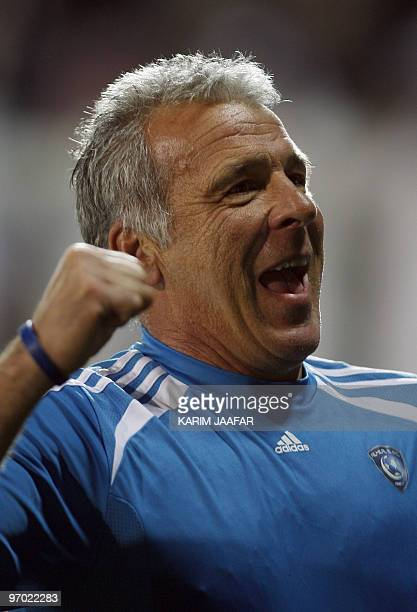 Saudi AlHilal club's Belgian coach Eric Gerets celebrates after winning over Qatar's AlSadd club during their AFC Champions League football match in...