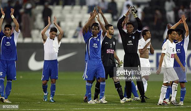 Saudi AlHilal football club players celebrate after winning over Qatar's AlSadd club during their AFC Champions League football match in Doha on...