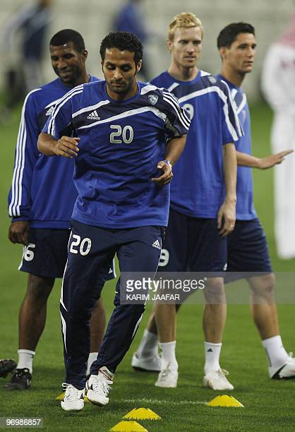 Saudi AlHilal football player Yasser alQahtani runs during a training session at the AlSadd stadium in Doha in preparation for their AFC Champions...