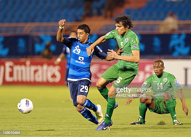 Saudi Al-Hilal Mohammed Salem and UAE's Al-Shabab Al-Arabi Waleed Abbas fight for the ball during their football match in the Group D, AFC Champions...