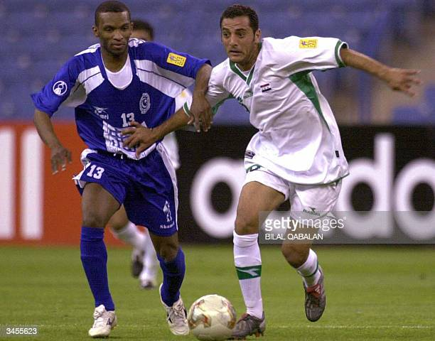 Saudi alHilal player Omar alGhambi fights for the ball against Amar Abbas of the Iraq Police club during their AFC Championship match in Riyadh 21...