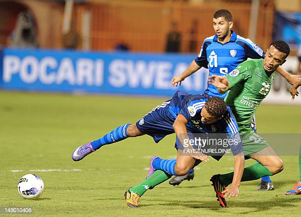 Saudi alHilal Yussef alArabi fights for the ball with UAE's AlShabab AlArabi Essam Dahahi during their football match in the Group D AFC Champions...