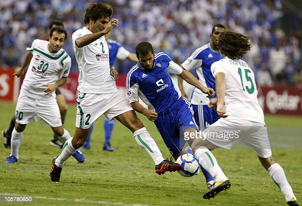 Saudi AlHilal's Ahmed alFraidi challenges Iranian Zobahan's Seyed Mohammad Hosseini and his Brazilian teammate Igor Castro during their AFC Champions...