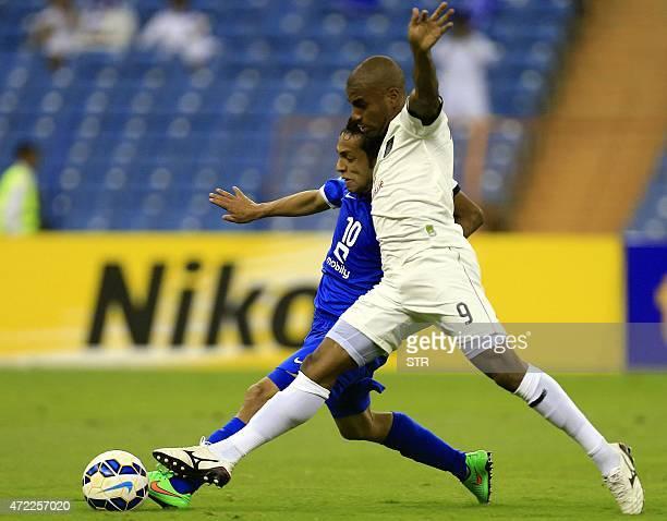 Saudi Al-Hilal's Moahmmed al-Shalhoub competes for the ball against Qatar's Al-Sadd club player Muriqui during their AFC Champions League group C...