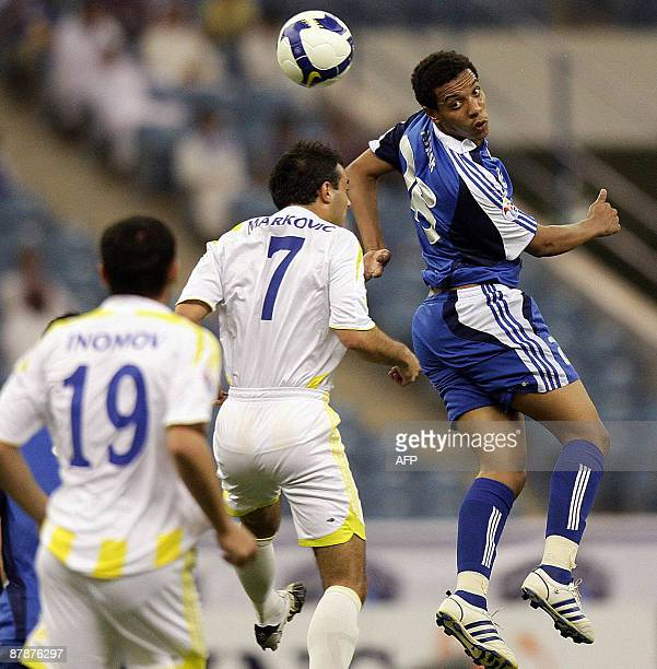 Saudi alHilal's Mohammed alAnbar heads the ball past Uzbek Pakhtakor's Darko Markovic and Islom Inomov during their AFC Champions League group A...