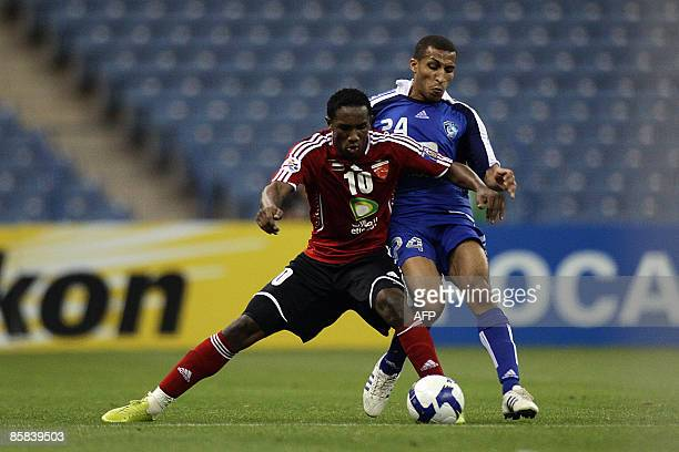 Saudi alHilal's Mohammed alNakhli vies for the ball with Emirati alAhli's Ahmed Khalil during their AFC Champions League group A football match in...