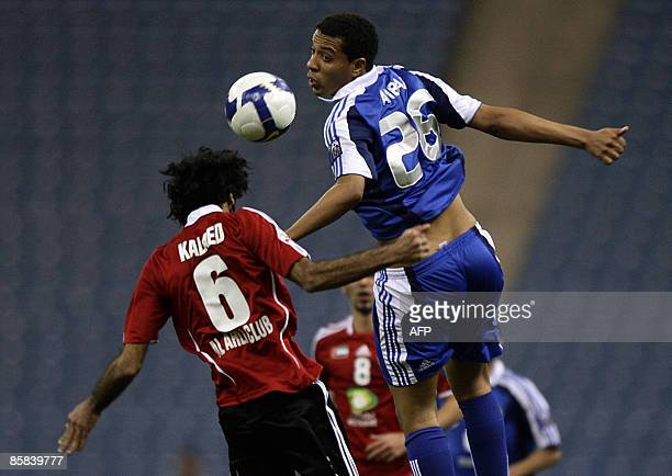 Saudi alHilal's Mohammed Anbar and Emirati alAhli's Khaled Mohammed jump to head the ball during their AFC Champions League group A football match in...