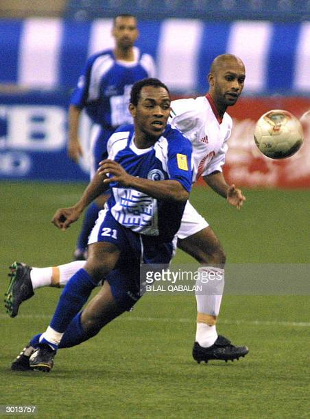 Saudi al-Hilal's Okin Trawri fights for the ball with United Arab Emirates' Sharjah club player Anderson during their Asian Champions League match in...