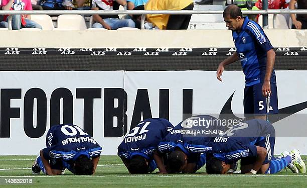 Saudi AlHilal's players pray as they celebrate after scoring a goal against Iran's Piroozi Athletic during their AFC Champions League group D...
