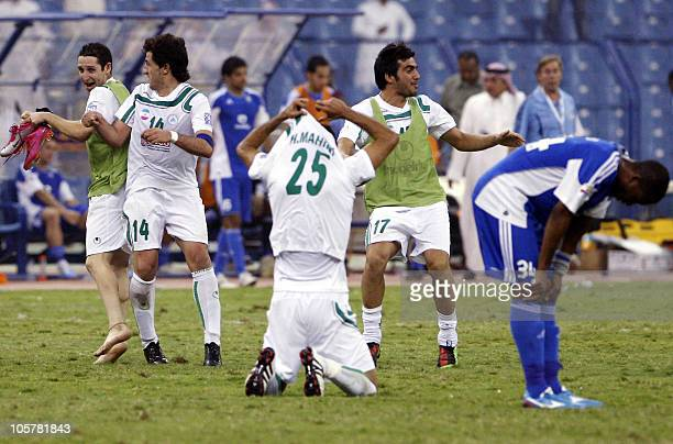 Saudi AlHilal's Walid alJizani reacts as players of Iran's Zobahan celebrate after winning their AFC Champions League semifinal football match in...