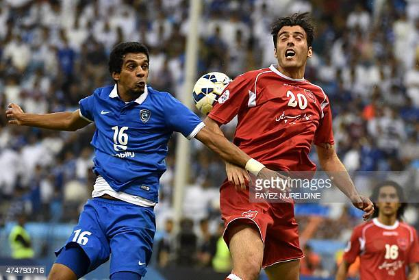 Saudi alHilal's Yousef alSalem fights for the ball with Iran's FC Persepolis' Ali Reza during their AFC Champions League football match on May 26 at...
