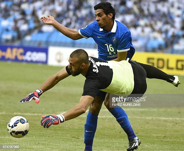 Saudi alHilal's Yousef alSalem fights for the ball with Iran's FC Persepolis' goalkeeper Sousah Makani during their AFC Champions League football...