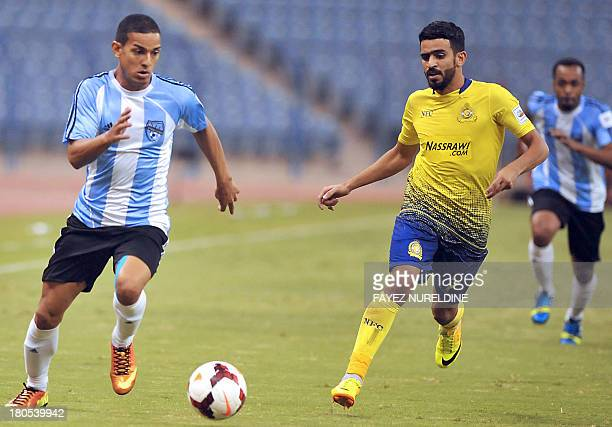 Saudi AlNahda player Renan Da Silva fights for the ball with AlNasr player Abdelrahim Jizawi during their Abdullatif Jamil league football match at...