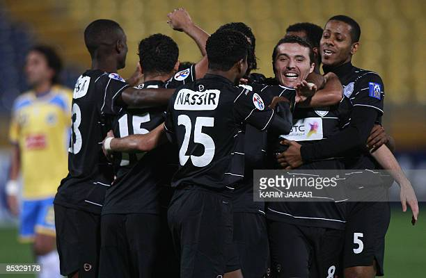 Saudi alShabab's Brazilian player Marcelo Ramiro Camacho celebrates with teammates after scoring a goal against alGharrafa during their AFC Champions...