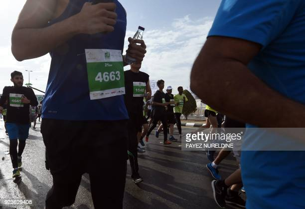 Saudi and foreign runners take part in the 2018 Riyadh marathon at the King Saud university in Riyadh on February 24 2018 / AFP PHOTO / Fayez...