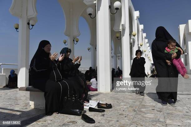 Saudi and foreign women pray during Friday prayer outside the mosque on the corniche in Jeddah Saudi Arabia on December 5 2014