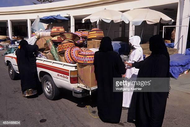 Saudi Arabia Abha Tuesday Market Veiled Women Shopping For Baskets