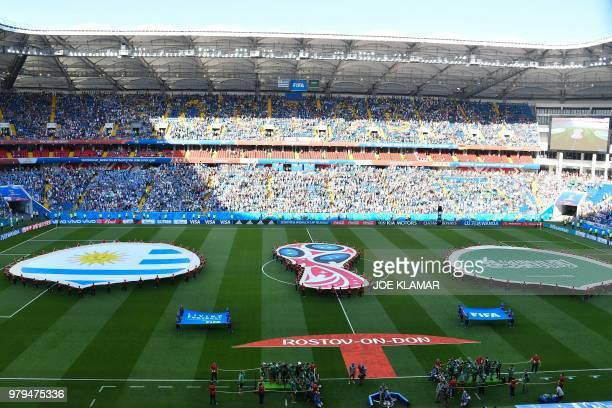 Saudi Arabia and Uruguay's giant flag are seen on the pitch before the start of the Russia 2018 World Cup Group A football match between Uruguay and...