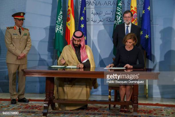 Saudi Arabia Crown Prince Mohammed bin Salman and Spanish Defence Minister Maria Dolores de Cospedal sign documents as Spanish President Mariano...