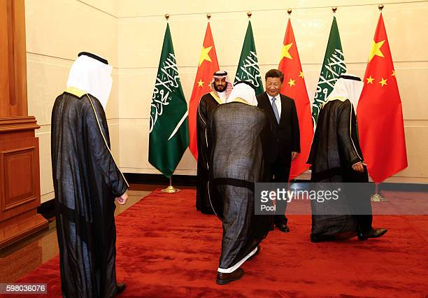 Saudi Arabia Deputy Crown Prince Mohammed bin Salman and Chinese President Xi Jinping greet arriving members of the Saudi delegation during a meeting...