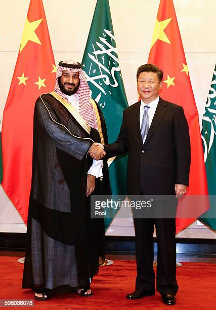 Saudi Arabia Deputy Crown Prince Mohammed bin Salman and Chinese President Xi Jinping shake hands during a meeting at the Diaoyutai State guest house...
