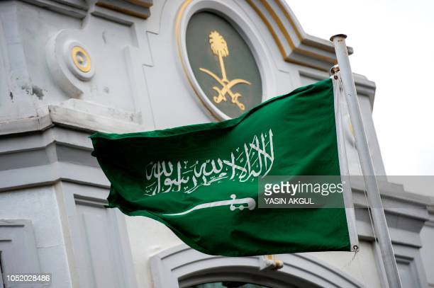 A Saudi Arabia flag flies in front of the Saudi consulate in Istanbul on October 13 2018 Saudi Arabia dismissed on Octiber 13 accusations that Jamal...