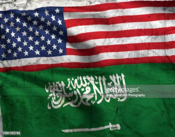 saudi arabia flag us flag texture horz - saudi arabian flag stock photos and pictures