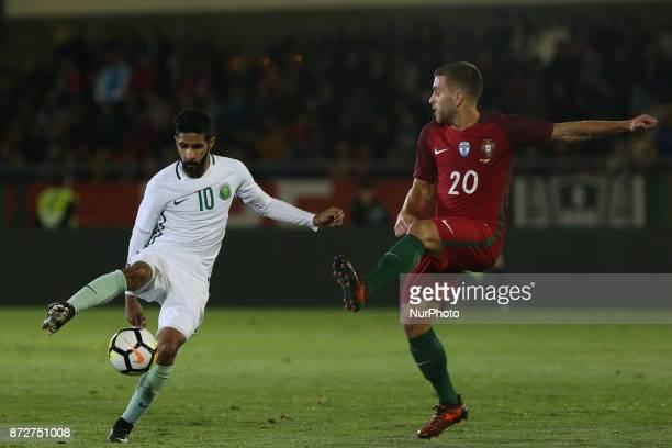 Saudi Arabia forward Hazzaa Al Hazzaa and Portugal defender Kevin Rodrigues during the match between Portugal v Saudi Arabia International Friendly...