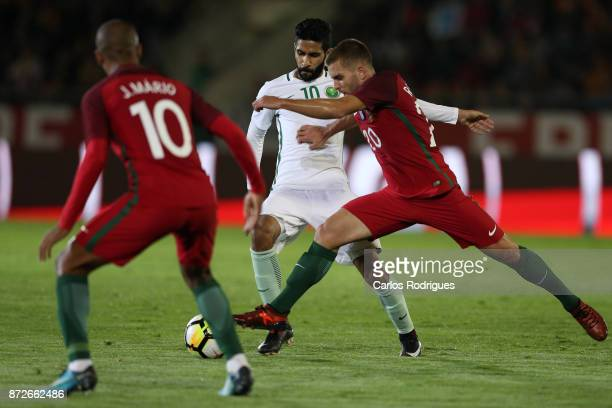 Saudi Arabia forward Hazzaa Al Hazzaa vies with Portugal defender Kevin Rodrigues for the ball possession during the match between Portugal and Saudi...