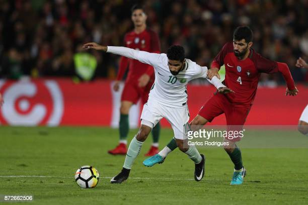 Saudi Arabia forward Hazzaa Al Hazzaa vies with Portugal defender Luis Neto for the ball possession during the match between Portugal and Saudi...
