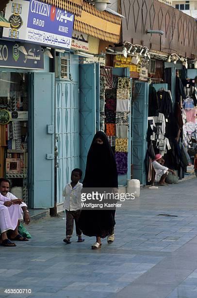 Saudi Arabia Jeddah Old Town Souk Alalawi Veiled Woman With Boy