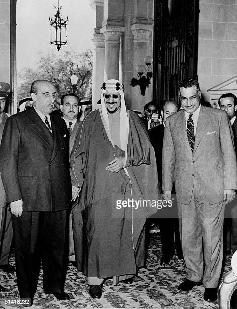 Saudi Arabia King Saud ibn Abd al-Aziz surrounded on his left by Egyptian president Gamal Abdul Nasser and on his right by Syrian president Shukri...