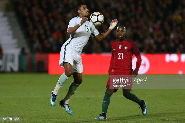 Saudi Arabia midfielder Salem Al Dawsari and Portugal defender Ricardo Pereira during the match between Portugal v Saudi Arabia International...