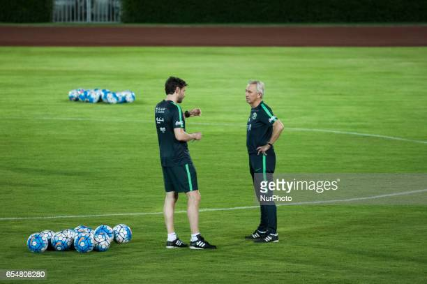 Saudi Arabia national football team head coach Bert van Marwijk and coach Mark van Bommel watches his players during a training session at the...