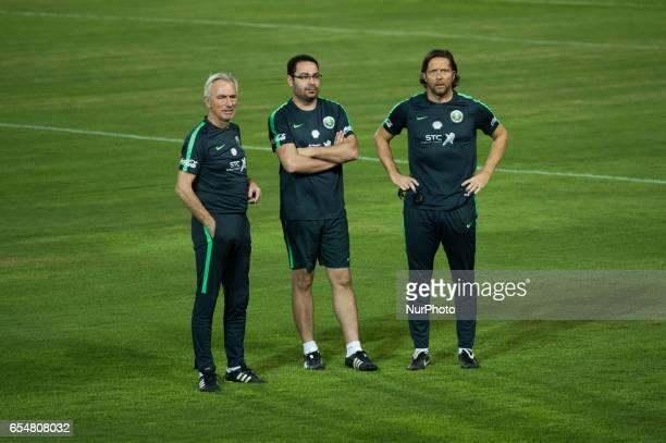 Saudi Arabia national football team head coach Bert van Marwijk watches his players during a training session at the Supachalasai Stadium in Bangkok...
