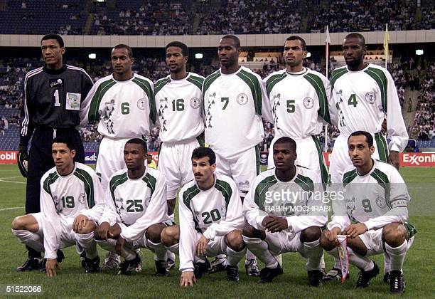 Saudi Arabia national soccer team players pose for a group picture 20 January 2002 in Riyadh before a Gulf Cup tournament match against Bahrain AFP...