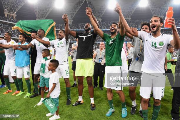 Saudi Arabia players celebrate their 10 victory and qualified for the FIFA World Cup Russia after the FIFA World Cup qualifier match between Saudi...