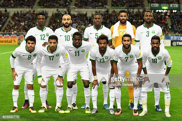 Saudi Arabia players line up for the team photos prior to the 2018 FIFA World Cup Qualifier match between Japan and Saudi Arabia at Saitama Stadium...