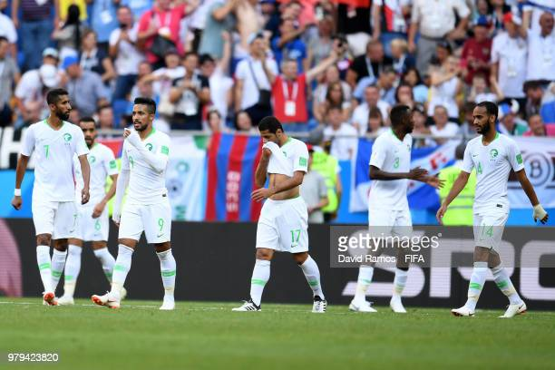 Saudi Arabia players look on dejected after conceding the first geoal to Uruguay during the 2018 FIFA World Cup Russia group A match between Uruguay...