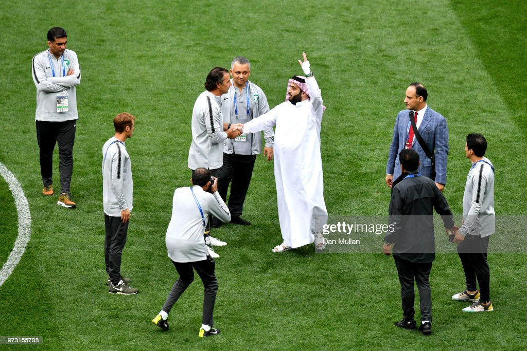Saudi Arabia Sports Minister Turki al-Sheikh shakes hands with Juan Antonio Pizzi, Head coach of Saudi Arabia during a Saudi Arabia training session ahead of the 2018 FIFA World Cup opening match against Russia at Luzhniki Stadium on June 13, 2018 in Moscow, Russia.