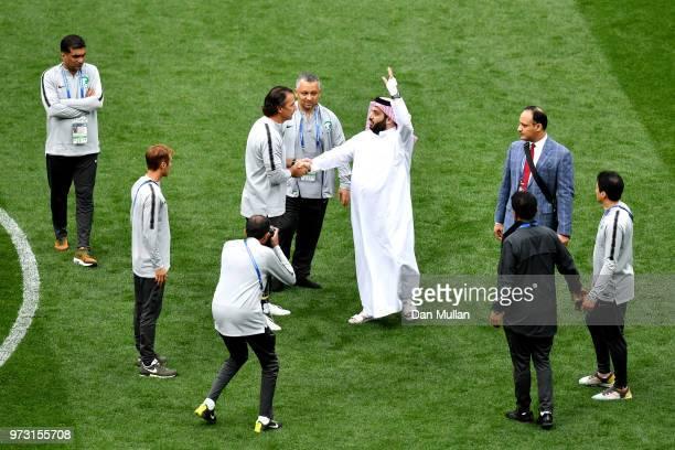 Saudi Arabia Sports Minister Turki alSheikh shakes hands with Juan Antonio Pizzi Head coach of Saudi Arabia during a Saudi Arabia training session...