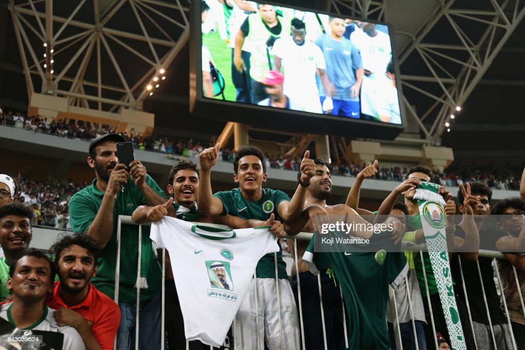 Saudi Arabia supporters celebrate their team's 1-0 victory and qualified for the FIFA World Cup Russia after the FIFA World Cup qualifier match between Saudi Arabia and Japan at the King Abdullah Sports City on September 5, 2017 in Jeddah, Saudi Arabia.